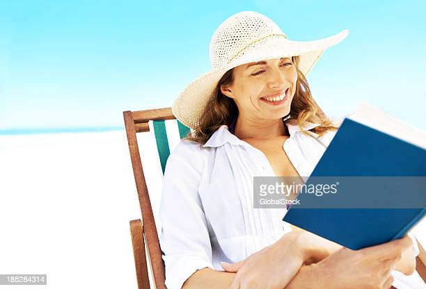 Enjoying a good read on the beach