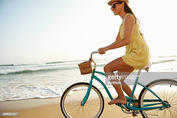 enjoying a leisurely beach cycle - sundress stock pictures, royalty-free photos & images