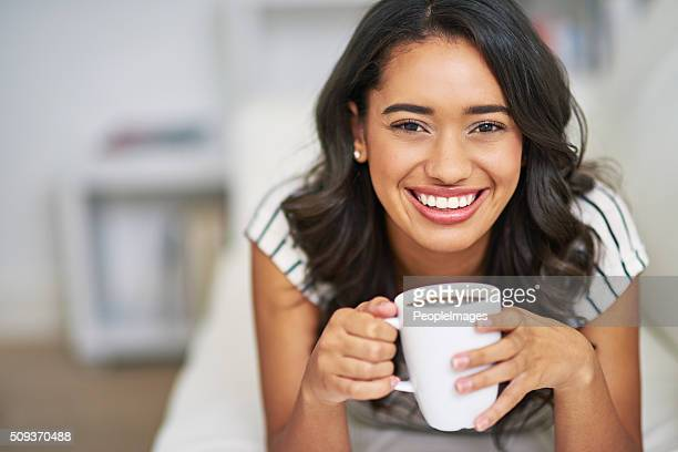 enjoying a little coffee on the couch - peopleimages stock pictures, royalty-free photos & images