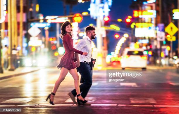 enjoying a night out together in las vegas - fremont street las vegas stock pictures, royalty-free photos & images