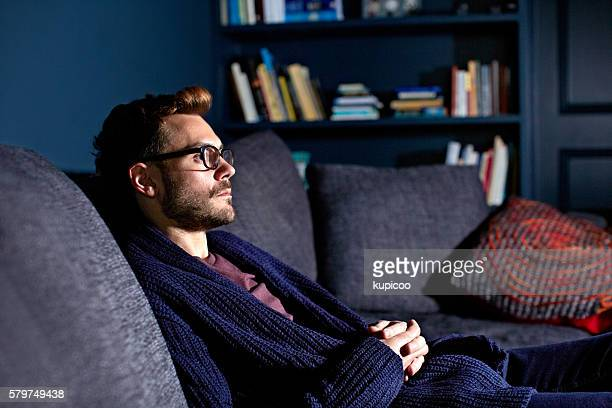 enjoying a quiet night to himself - smart casual stock pictures, royalty-free photos & images