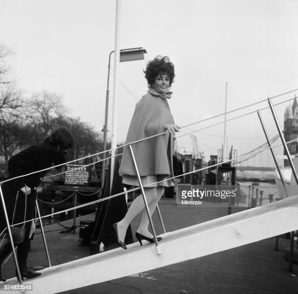 Enjoying a rather expensive quarantine the dogs of Elizabeth Taylor and Richard Burton are aboard the family yacht moored off Tower Pier The Burton's...