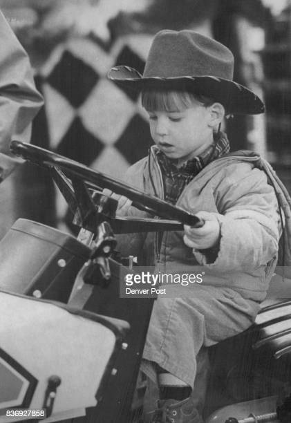 Enjoying A Ride at the Stock Show Andrew Collins 21/2yearold from Cheyenne Wyo enjoys a ride in fantasy on an Allis Chalmers Simplicity tractor at...