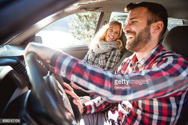 enjoying a road trip - heterosexual couple stock pictures, royalty-free photos & images