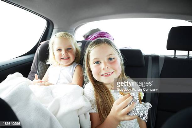 Enjoying a snack in the car