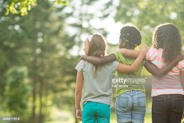 enjoying a sunny day at the park - local girls stock photos and pictures