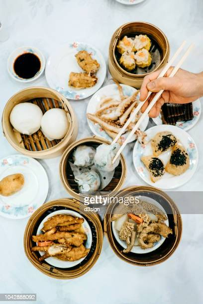 enjoying a variety of chinese traditional dim sum in chinese restaurant - asian food stock pictures, royalty-free photos & images