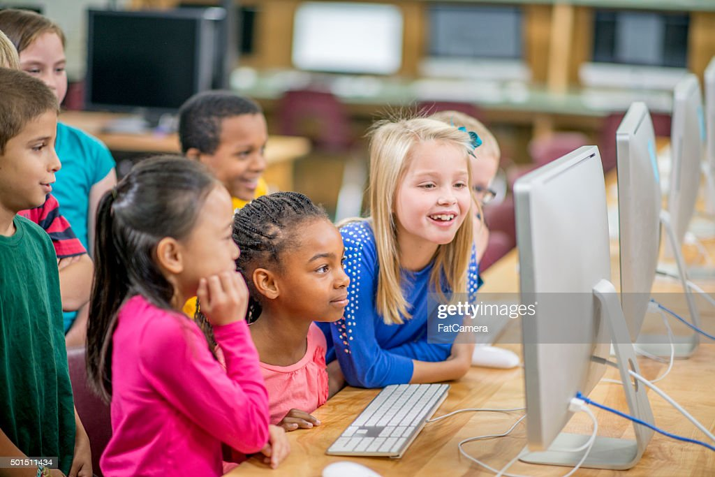 Enjoying a Video in the Computer Lab : Stock Photo