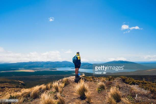 enjoying a view during hike. - new zealand stock pictures, royalty-free photos & images