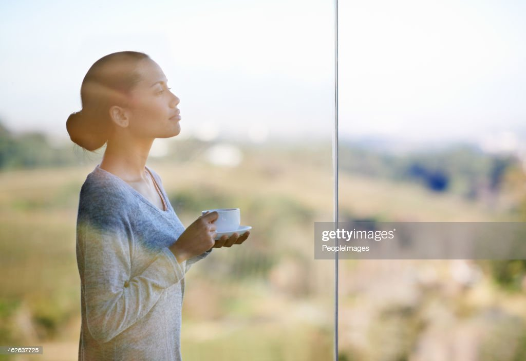 Enjoying a warm cup of coffee while surrounded by nature : Stock Photo