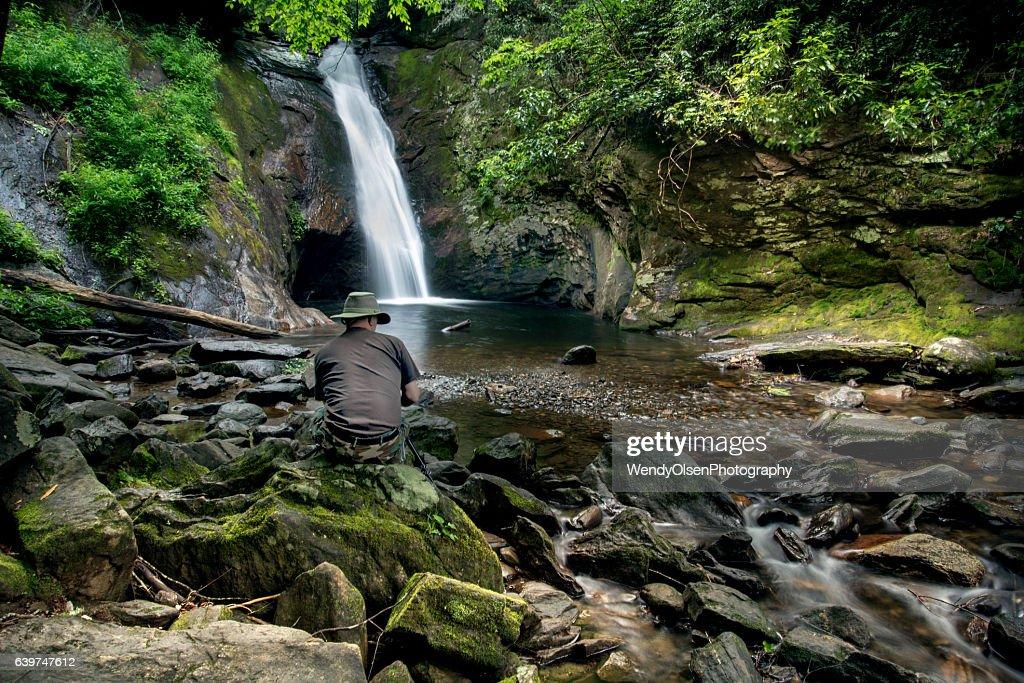 Enjoying a waterfall : Stock Photo