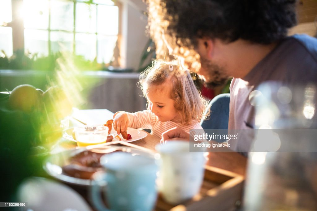 Enjoying a wholesome breakfast with dad : Stock Photo