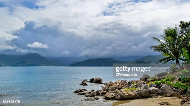 enjoying almada beach. - crmacedonio bildbanksfoton och bilder