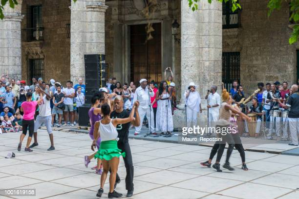 enjoying and dancing on the street at havana, cuba. - havana stock pictures, royalty-free photos & images