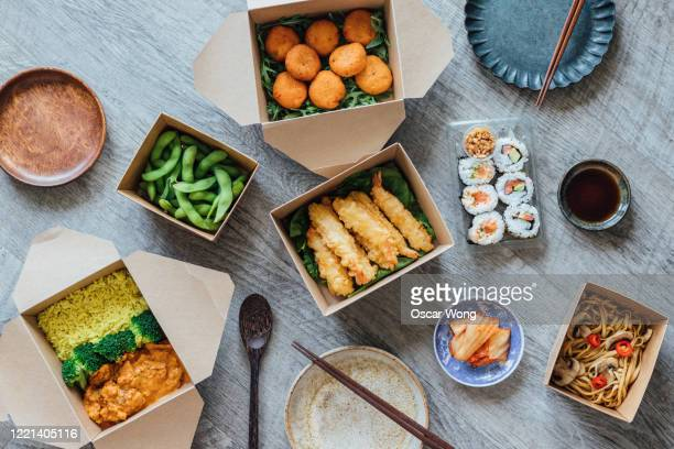 enjoying assorted takeaway meal at home - take away food stock pictures, royalty-free photos & images