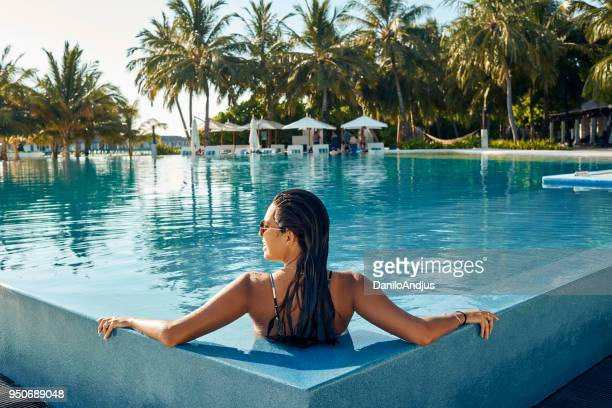 enjoying at the pool - luxury stock pictures, royalty-free photos & images