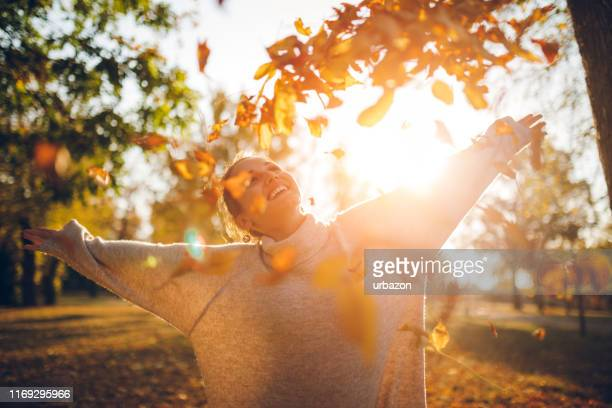 enjoying autumn park - autumn stock pictures, royalty-free photos & images