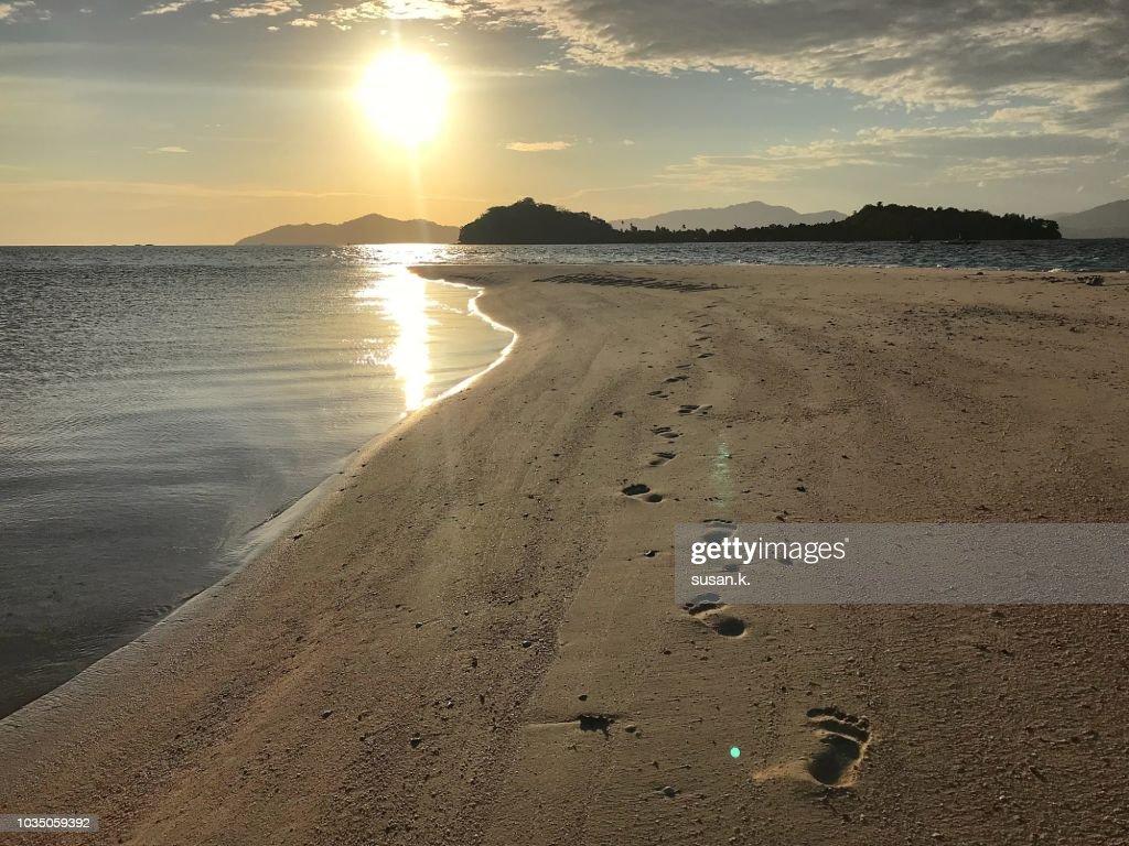 Enjoying beautiful sunrise on tropical island. : Stock Photo