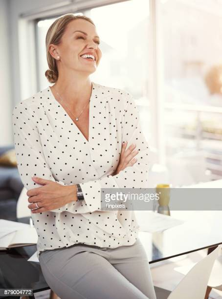 enjoying being an entrepreneur - one mature woman only stock pictures, royalty-free photos & images