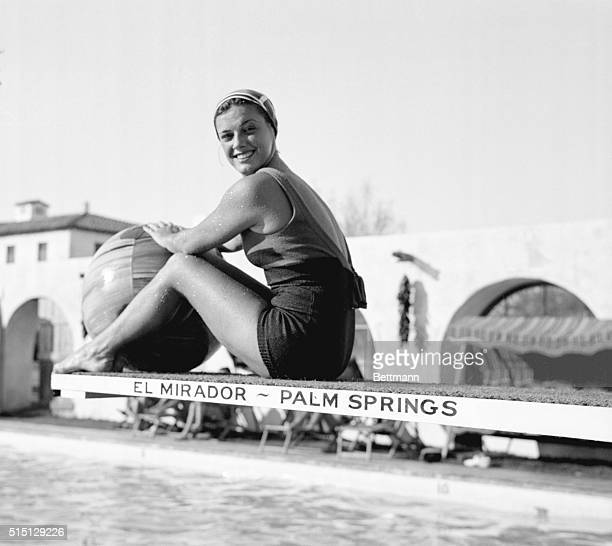 Enjoying California's Warm Christmas Sun Palm Spring California Eleanor Holm seated on the springboard of the pool at El Mirador Hotel Palm Springs...