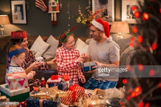 enjoying christmas morning - christmas stock pictures, royalty-free photos & images