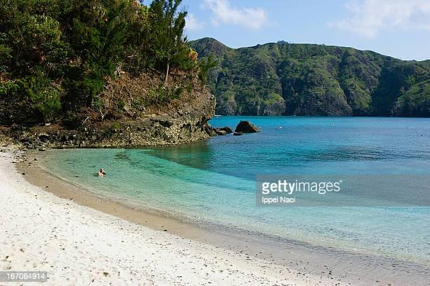 Enjoying clear tropical water of white sandy beach