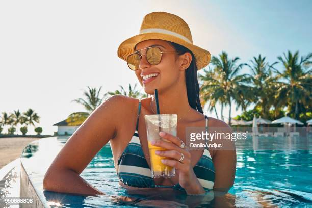 enjoying cocktail at the pool - refreshment stock pictures, royalty-free photos & images