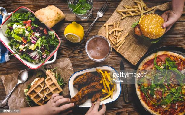 enjoying dinner - chicken and waffles stock photos and pictures