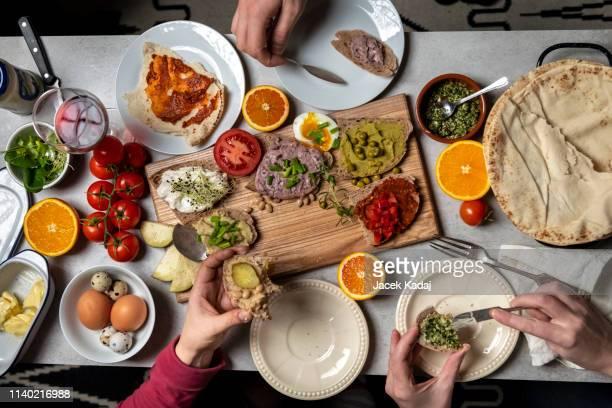 enjoying dinner together. - マゾフシェ県 ストックフォトと画像