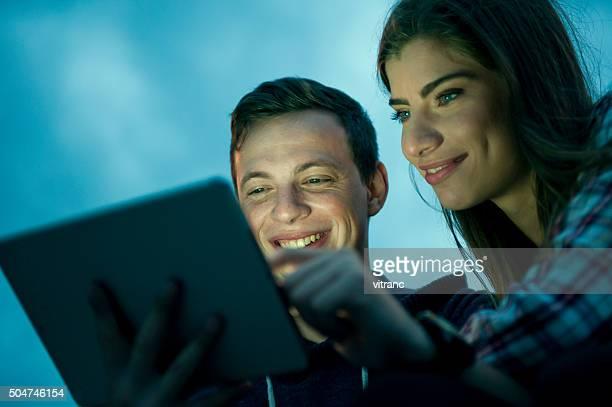 Enjoying  evening with digital tablet