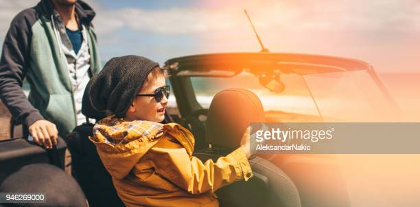 enjoying family road trip - domestic car stock pictures, royalty-free photos & images