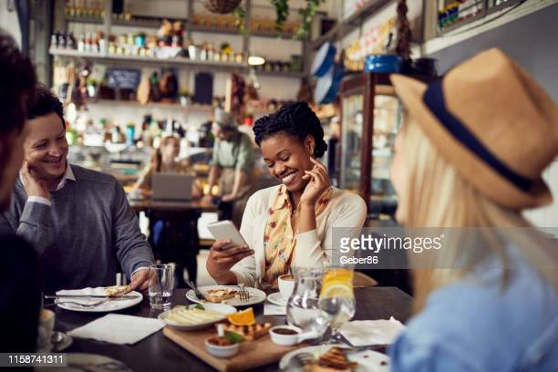 enjoying food - restaurant stock pictures, royalty-free photos & images
