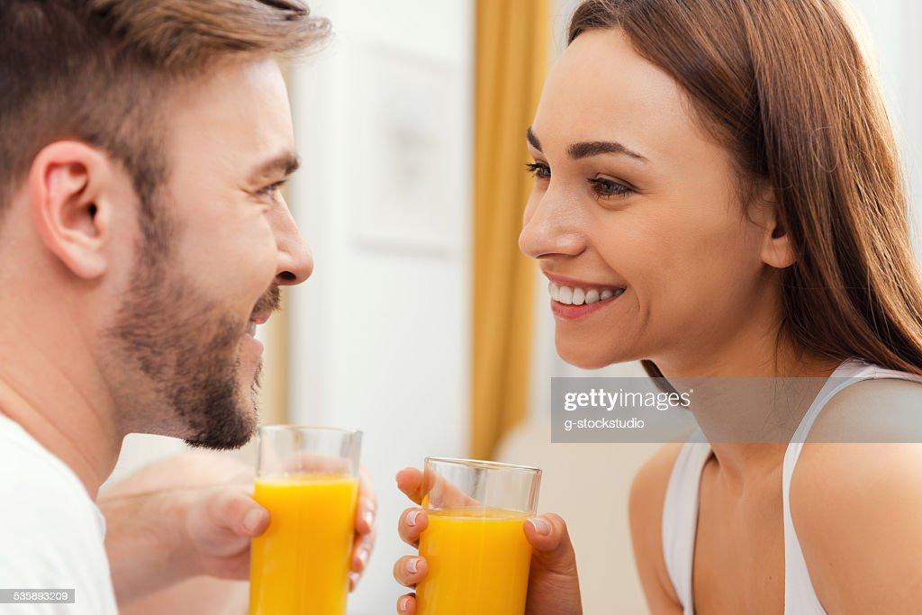 Enjoying fresh juice together. : Stock Photo