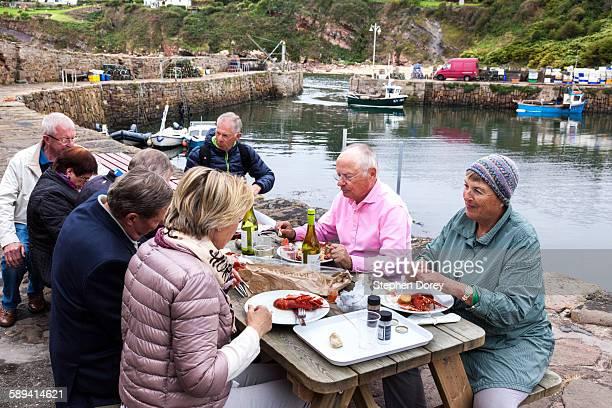 Enjoying fresh lobsters, Crail