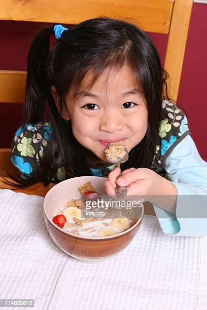 Enjoying her cereal