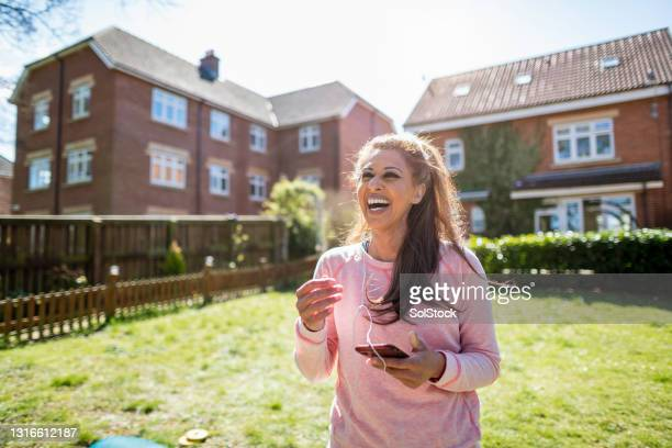enjoying her morning routine - real people stock pictures, royalty-free photos & images