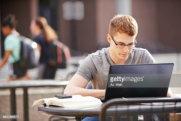 enjoying his studies - e learning stock photos and pictures