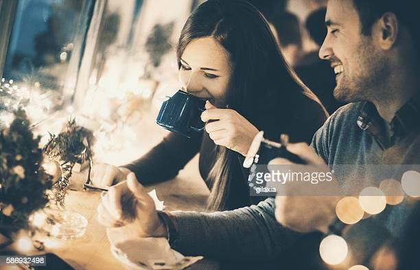 Enjoying hot tea on cold winter night.