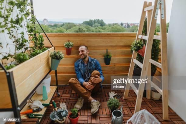 enjoying in a small garden - urban garden stock photos and pictures