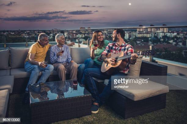 Enjoying in a sound of acoustic guitar on a penthouse terrace!