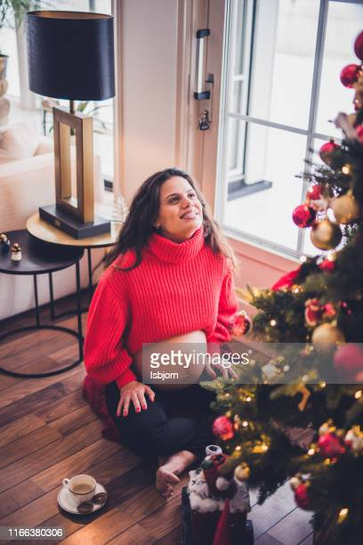 enjoying in christmas time whit coffee. - one young woman only stock pictures, royalty-free photos & images