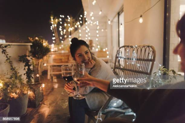 enjoying in good wine and great company - cosy stock pictures, royalty-free photos & images