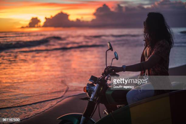 enjoying in sunset - muscle men at beach stock photos and pictures
