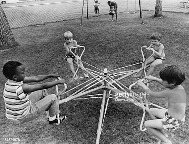 Enjoying Kiddie Korral are, from left, Chris Jones, 9; Matthew Hoodley, 4; Moira Ann Carter and Christopher Hoodley, 5.;