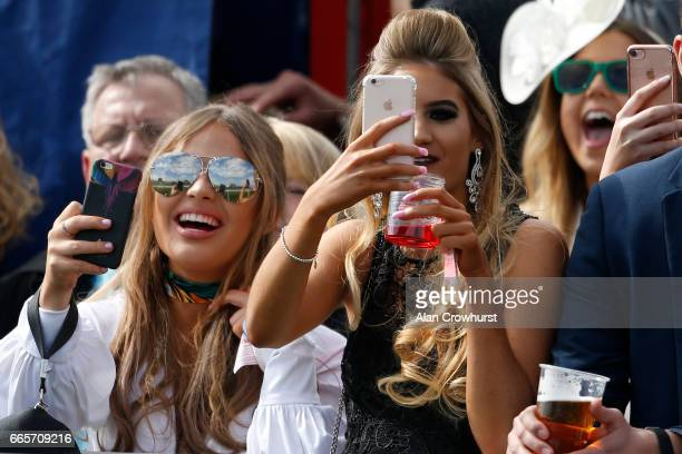 Enjoying Ladies Day at Aintree Racecourse on April 7, 2017 in Liverpool, England.