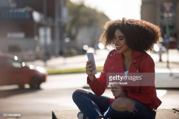 Enjoying life - teenager on phone