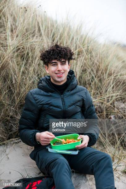 enjoying lunch alone - boys stock pictures, royalty-free photos & images