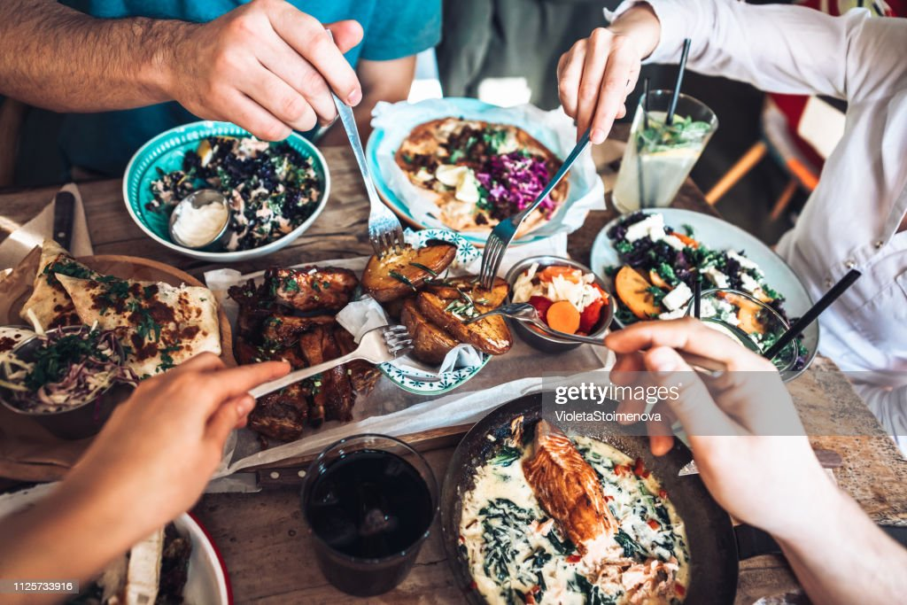 Enjoying lunch with friends : Stock Photo