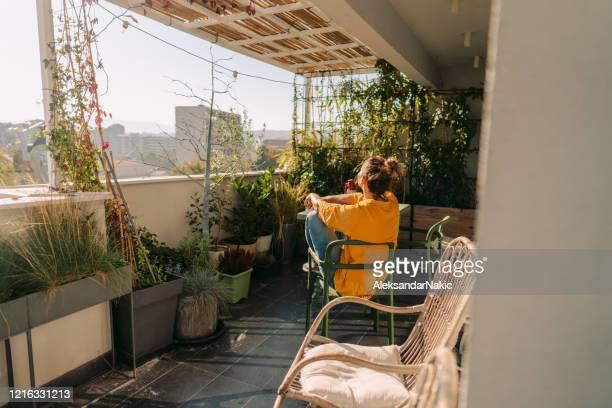 enjoying lush foliage on my balcony - sunbathing stock pictures, royalty-free photos & images