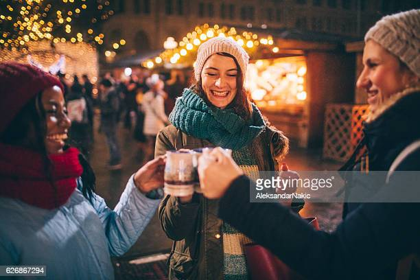 enjoying mulled wine on christmas market - town hall square stock pictures, royalty-free photos & images